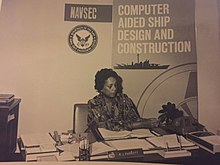 photograph of Raye Montague working at her desk