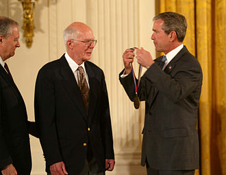 Raymond Davis Jr. - Davis receiving the Medal of Science from President Bush, with OSTP Director Marburger on the left