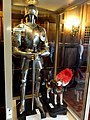 A full set of armor and a manikin of a dog in armor.