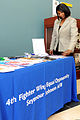 Rhonda Christie, director of the U.S. Air Force 4th Fighter Wing Equal Opportunity program, sets up a display of informational handouts, office supplies and personal items during an information fair on Seymour 130423-F-JH807-018.jpg