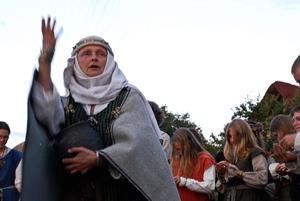 Modern Paganism in World Cultures - Romuvan priestess leading ritual.