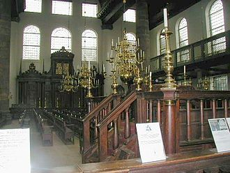 Bema - Interior of the Amsterdam Synagogue: the bema (or tebáh) is in the foreground, and the Hekhál (Ark) in the background.