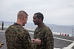 Sailor receives an award 150312-M-CX588-078.jpg