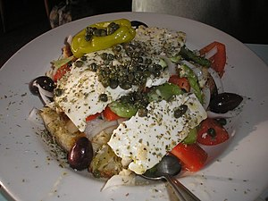 Greek salad - Horiatiki salad, also called Mediterranean salad or Cretan salad, as served on Crete