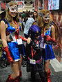 San Diego Comic-Con 2011 - Hit Girl poses with 2 Captain America girls (5976788761).jpg