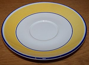 Saucer - Image: Saucer with yellow and white design