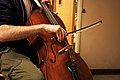 Sean on the Contact-Mic'd Cello - Milwaukee Makerspace music club, 2011-02-07 (photo by Jason Gessner).jpg