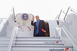Secretary Kerry Waves Goodbye Before Boarding the Final Flight of HIs Tenure in Davos (31584171133).jpg