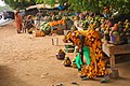 Senegalese women selling mangoes and other fruits.jpg