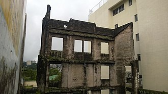 Baguio - An office building along Session Road destroyed by artillery fire during the Battle of Baguio and not rebuilt as of 2018