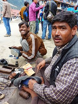 Shoemakers on the roadside, Rekong Peo, Himachal Pradesh, India
