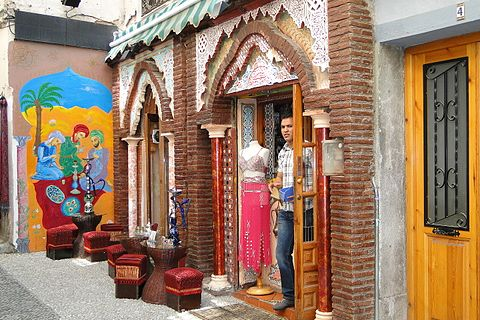 Shopworker in the Little Morocco Quarter Granada Spain