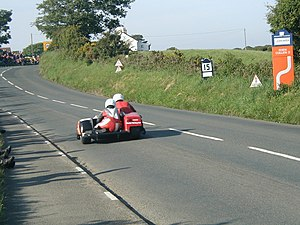 Rhencullen - Sidecar crew approaching Rhencullen 3 in 2003
