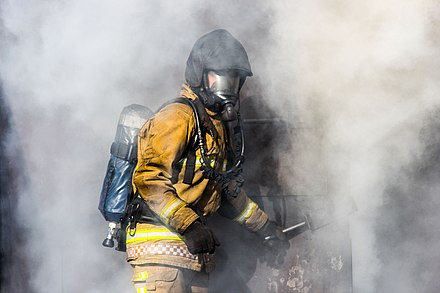 A Staffordshire Fire and Rescue Service firefighter, training in a smoke house Smoke house training.jpg