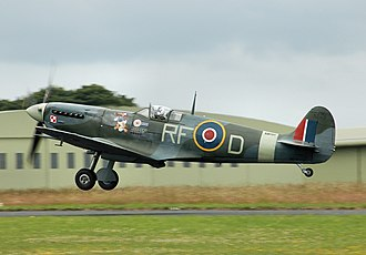 Battle of Britain Memorial Flight - Spitfire AB910, built in 1941, she is painted in the colours of the Polish 303 Squadron; the Donald Duck symbol is the personal logo of Squadron Leader Jan Zumbach