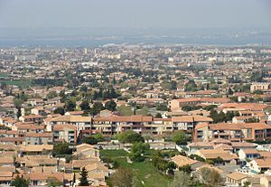 Gignac-la-Nerthe - The Laure District of Gignac-la-Nerthe, with Marignane and the Étang de Berre, seen from the hill of Saint-Michel