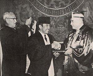Grayson L. Kirk - Kirk (right) granting an honoris causa degree to Sukarno (1956)