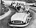 Sukarno riding mini car with Walt Disney, Aneka Amerika 102 (1957), p32.jpg