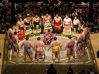 Mawashi - Modern sumo wrestlers in top division ring entrance ceremony, wearing keshō-mawashi