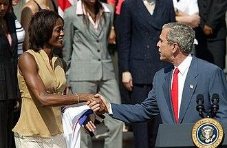 Swin Cash - Swin Cash meets George W. Bush after winning the WNBA Championship with the Detroit Shock.