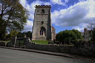 St Andrew's Church, Wroxeter - The church's tower with the gate piers in front re-using Roman materials.