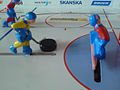 Table hockey player with puck.jpg