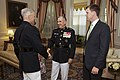 The 35th Commandant of the Marine Corps, Gen. James F. Amos, left, greets Gen. George J. Flynn, center, at the Home of the Commandants prior to Flynn's retirement ceremony at Marine Barracks Washington 130509-M-LU710-094.jpg