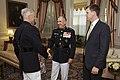 The 35th Commandant of the Marine Corps, Gen. James F. Amos, left, greets Gen. George J. Flynn, center, at the Home of the Commandants prior to Flynn's retirement ceremony at Marine Barracks Washington 130509-M-LU710-094.jpg