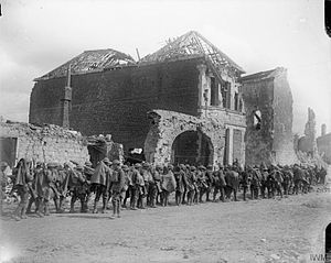 37th Division (United Kingdom) - Troops of the 10th (Service) Battalion, Royal Fusiliers halted in Arras, France, before going into action, 9 April 1917.