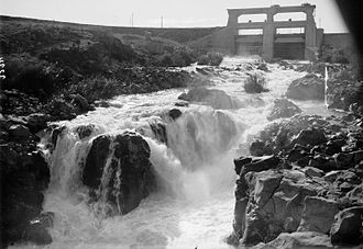 War over Water (Jordan river) - Flood waters exiting from the Yarmuk reservoir to the Yarmuk river, 1933