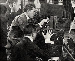 John van den Broek - van den Broek, kneeling, with director Maurice Tourneur on left and cinematographer Lucien Andriot sitting at camera. On the set of The Poor Little Rich Girl