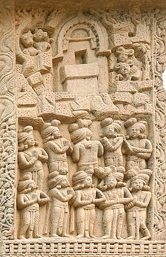 Indrasala Cave - The Visit of Indra to the Buddha in the Indrasaila cave. The Buddha is symbolized by his throne. Wild animal are depicted around the cave. Stupa 1 Northern Gateway, Sanchi. 1st century BCE/CE.