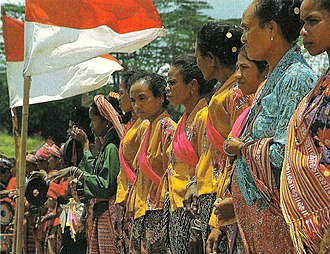 Indonesian occupation of East Timor - Timorese women with the Indonesian national flag