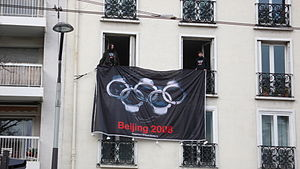 Reporters Without Borders - RWB handcuffs as Olympic rings protesting 2008 Olympics in China