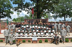 Law Enforcement Exploring - Twenty-nine Explorers graduate the National Law Enforcement Explorer Academy during a ceremony held on Fort Leonard Wood's Military Police Memorial Grove, July 19.