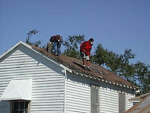 Two w:roofers at work in New Orleans, Louisiana.