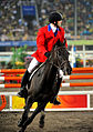 U.S. Air Force Capt. Eli Bremer rides his horse, Dangdang, to a 14th-place finish worth 1,060 points in the equestrian show jumping portion of the modern pentathlon during the Beijing 2008 Olympic Games 080821-A-MX671-007.jpg