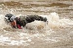 U.S. Air Force Staff Sgt. Daniel Holmes battles the current as he conducts swift water rescue training during exercise Angel Thunder 2013 near Davis-Monthan Air Force Base, Ariz., on April 10, 2013 130410-F-PD696-821.jpg