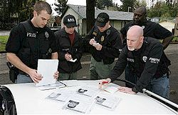 U.S. Marshal Multi-Agency Team Members Preparing.jpg