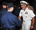 U.S. Navy Rear Adm. Mark D. Guadagnini, right, deputy commander with fleet management and chief of staff of U.S. Fleet Forces Command, congratulates a recruit following a capping ceremony at Recruit Training 120817-N-IK959-169.jpg