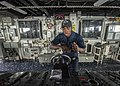 U.S. Navy Seaman Maurice Walls steers the ship while standing helmsman watch aboard the guided missile destroyer USS Donald Cook (DDG 75) March 31, 2014, in the Mediterranean Sea 140331-N-KE519-009.jpg