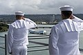 U.S. Sailors aboard the amphibious assault ship USS Peleliu (LHA 5) salute as the ship passes the USS Arizona Memorial June 27, 2014, before pulling into Joint Base Pearl Harbor-Hickam, Hawaii, to participate 140627-N-YW024-131.jpg