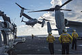 U.S. Sailors watch as a Marine Corps MV-22B Osprey tiltrotor aircraft assigned to Marine Medium Tiltrotor Squadron (VMM) 163 takes off from the amphibious assault ship USS Makin Island (LHD 8) in the Pacific 140825-N-KL846-113.jpg