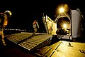 U.S. service members walk into the logistics support vessel USAV Lt. Gen. William B. Bunker (LSV 4) to offload Marine Corps M1A1 Abrams tanks during the Combined Joint Logistics Over the Shore naval exercise in P 130419-N-LO372-139.jpg