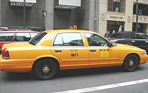 Taxicabs of New York City - New York medallion taxicab in a prior livery. The medallion number is on the side of the taxicab.