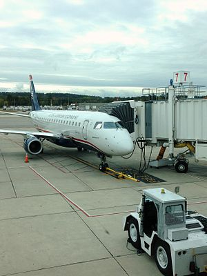 Manchester–Boston Regional Airport - A US Airways Express Embraer 175 parked at gate 7