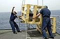 US Navy 020724-N-0111R-004 A Boatswain's Mate aboard USS La Salle directs the Crane Operator to lower a MK-7 Life Raft.jpg