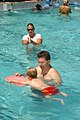US Navy 030703-N-0106C-002 Cmdr. Noel Russnogle helps his son on a kickboard in Towers Pool. Russnogle's son was one of 45 Navy children who completed swim lessons Jul 3rd at the pool.jpg