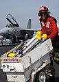 US Navy 040309-N-3986D-095 Aviation Ordnanceman 3rd Class Joseph Little, of Tampa, Fla., moves Bols chaff loaders across the flight deck aboard USS George Washington (CVN 73).jpg