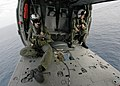 US Navy 040423-N-4190W-001 Search and Rescue Swimmer (SAR) members sit in a MH-60s Knighthawk helicopter during an vertical replenishment.jpg